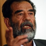 Saddam_Hussein_at_trial_July_2004-edit1-150x150